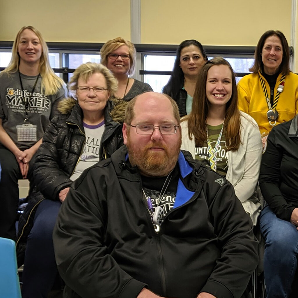 Several members of the Vinton-Shellsburg School District staff seated in a classroom together.