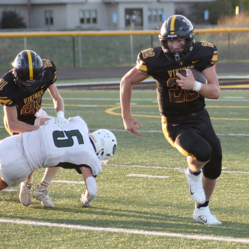 Viking football player running for a touch down.