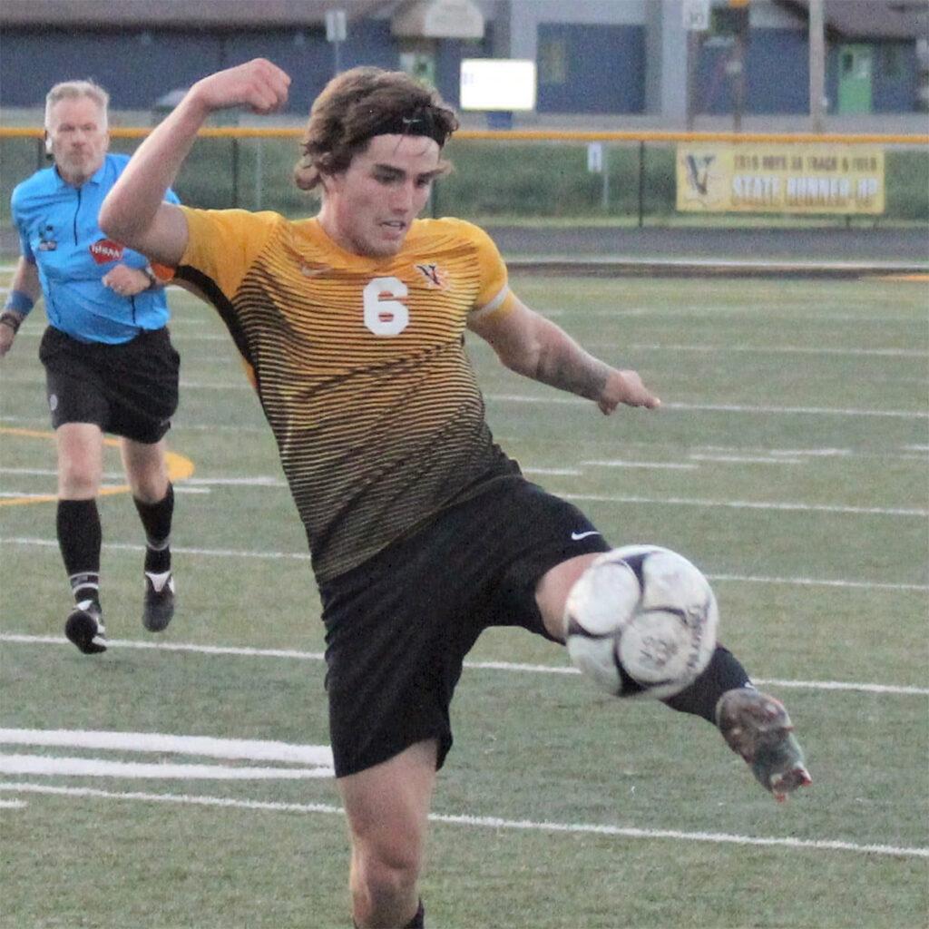 Male Viking soccer player kicking the ball.