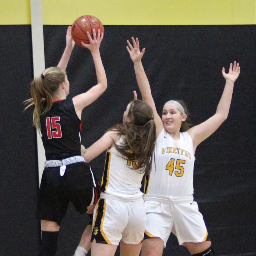 Girls playing a high school basketball game in the Vinton-Shellsburg gym.