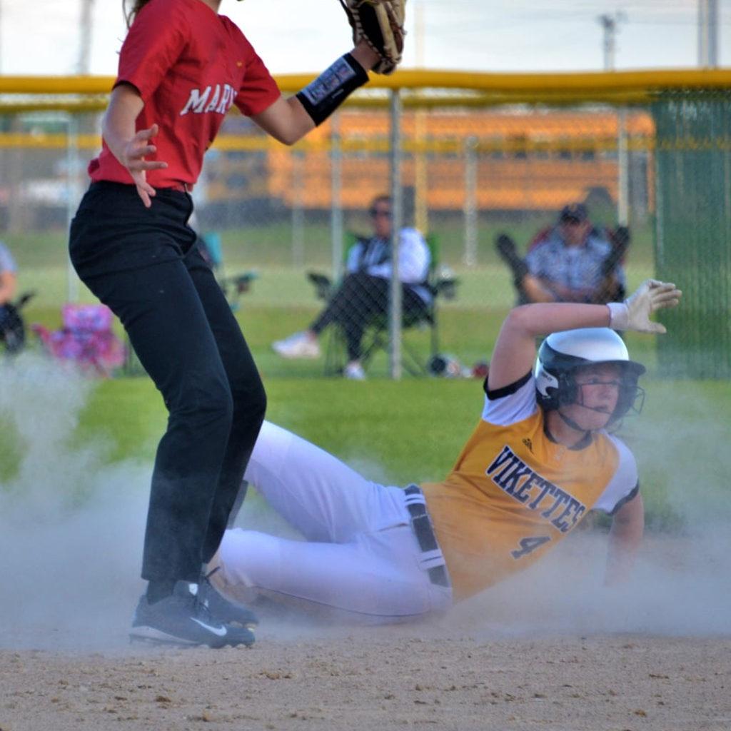 Vikette softball player slides into base.