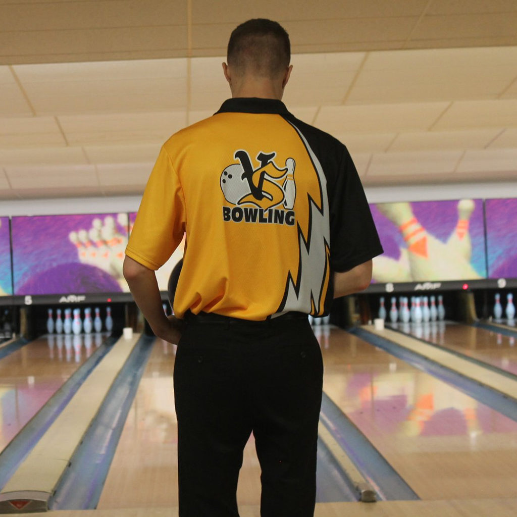 A Viking bowler stands in front of his lane ready to roll a strike.