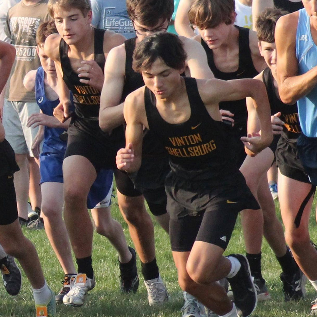 Runners at the starting line of a cross country meet.