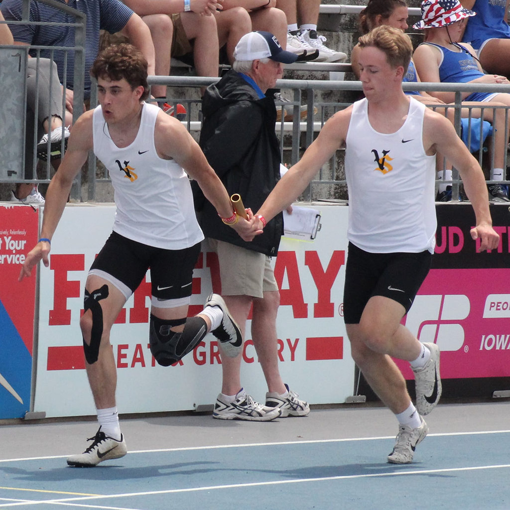 A Viking track team members passes the baton to is team mate during a relay race.